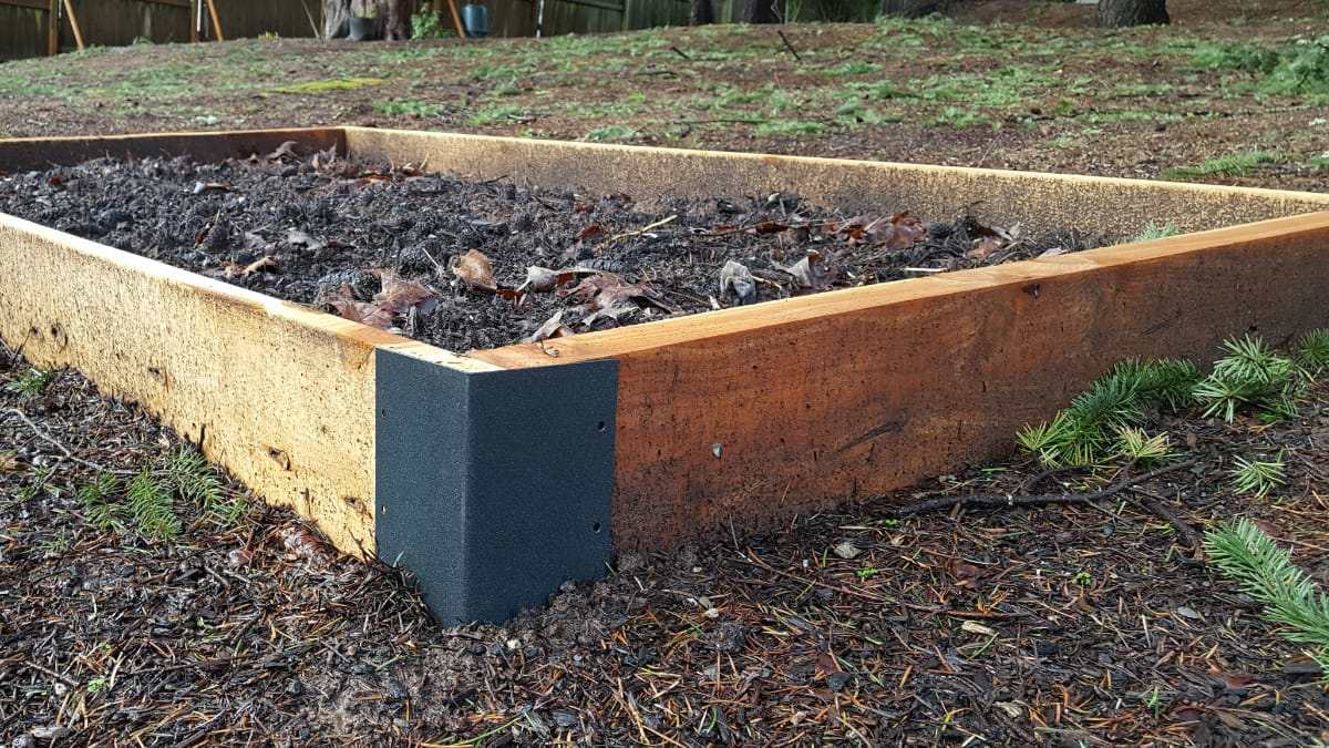 Raised garden bed ready for planting made from Juniper lumber and Clackamas corners.