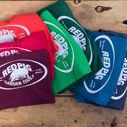 Red Pig shirts are available in a variety of colors in all gender sizes from small to XX large.
