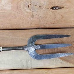A gardening hand fork with flat tines for maintaining well cultivated soil.