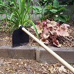 The peasant hoe is not typically used in a well maintained garden bed, but it sure looks good.